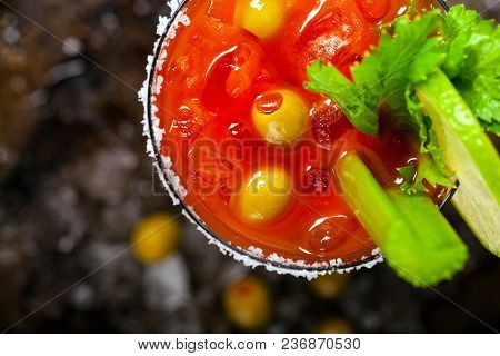 Bloody Mary Cocktail With Vodka And Tomato Juice, Tabasco Sauce And Ice Decorated With Celery. Selec