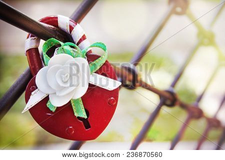 Red Lock Of Love With White Flower