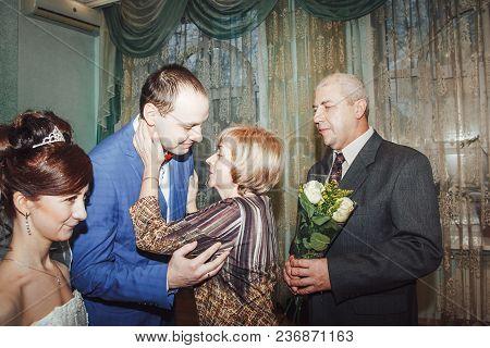 Russia, Kirov - November 24, 2017: Guest Or Relative Congratulates Bride And Groom In The Registry O