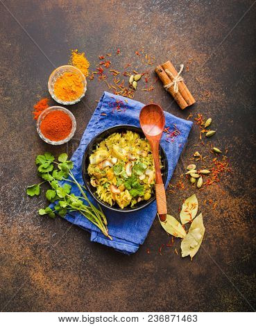 Biryani Rice, Traditional Indian Dish. Biryani Spicy Rice, Chicken, Nuts. Indian Rice Bowl, Spices,