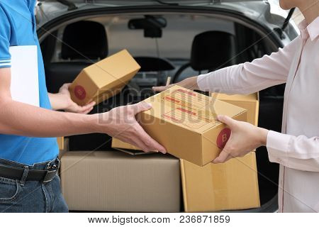 Woman Receive Package From Delivery Man. Male Postal Courier Person Deliver Box