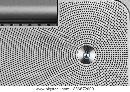 Metal Blue Power Io Button On The Aluminium Perforated Surface