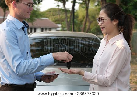 Salesman Give Car Key To Customer. Woman Buying Car From Dealer. Auto Business, Transportation Owner