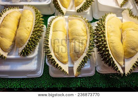 Pieces Of Durian Fruit In White Foam Plate On Display For Sale. Close Up Yellow Fresh Durain Is King