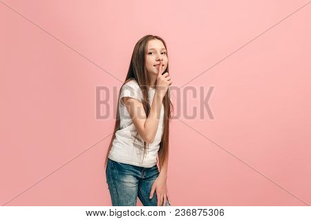 Secret, Gossip Concept. Young Teen Girl Whispering A Secret Behind Her Hand Isolated On Trendy Pink