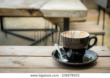 Morning Coffee In The Drink Is Almost Gone, With A Wooden Table Background.
