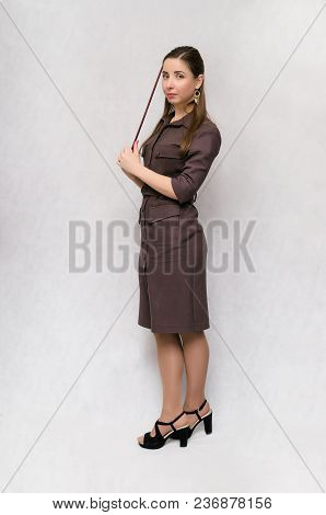 Full Length Teacher Or Financial Advisor Or Student Girl With School Pointer Isolated On Gray Backgr