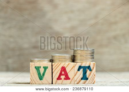 Block In Word Vat (abbreviation Of Value Added Tax) With Coin In Up Trend On Wood Background