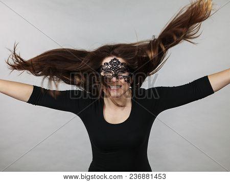 Happy Pretty Mysterious Woman Wearing Black Eye Lace Mask Having Tousled Windblown Long Brown Hair.