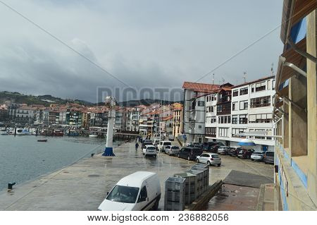 Beautiful Shot Of The Wooden Buildings Of The Port District On The Bay Taken From The Lonja De Lekei