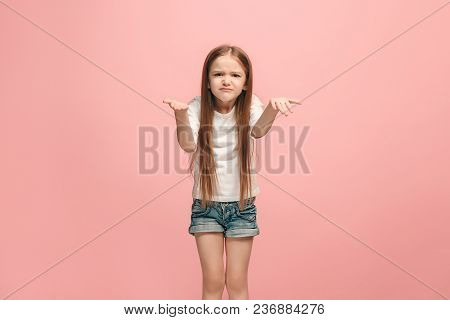 Why Is That. Beautiful Female Half-length Portrait On Trendy Pink Studio Backgroud. Young Emotional