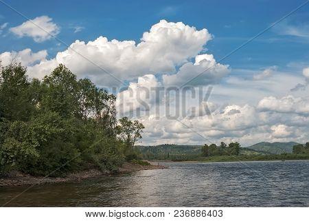 large Cumulus clouds of unique shape against the blue sky poster