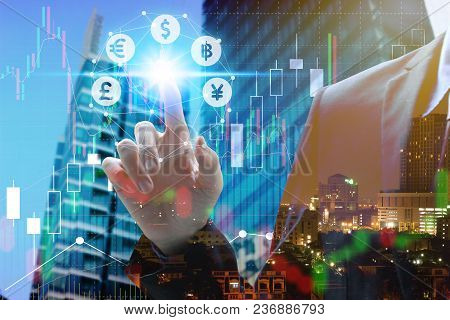 Double Exposure Of Businessman Touch Virtual Currency With Cityscape And Stock Market Or Financial G