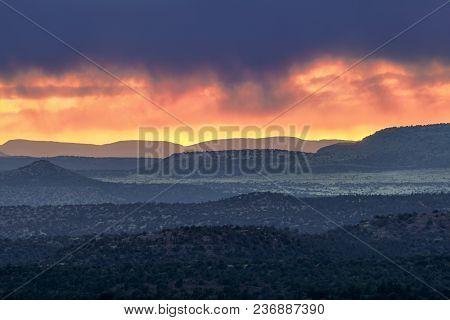 The Sun Sets With A Burst Of Color On The Distant Arizona Horizon Near Sedona.