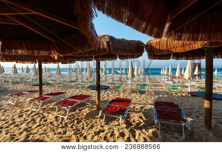 Morning Paradise White Sandy Beach The Maldives Of Salento With Sunshades And Sunbeds (pescoluse, Sa