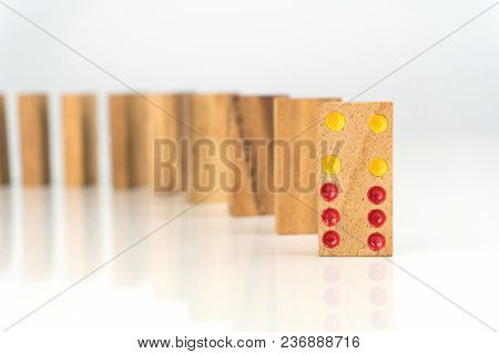 Wooden Dominoes Standing In A Row On White Table