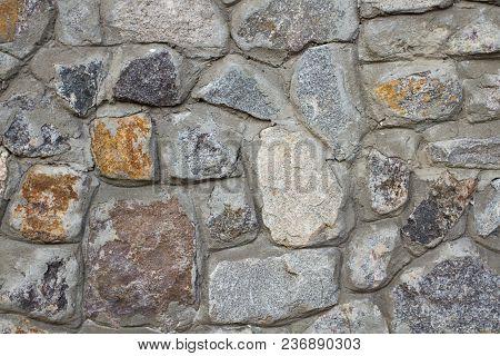 Brick Wall Of A Wild Stone Close Up