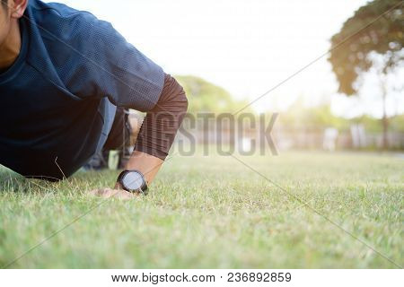 Male Athlete Exercising Push Up Outside In Sunny Sunshine
