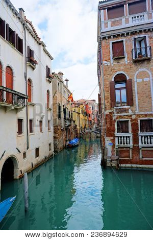 Venice, Veneto / Italy - March2018: Colorful Buildings Line The Waterway In Venice, Italy.