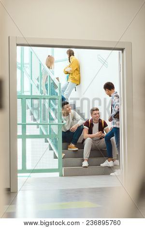 Group Of High School Students Spending Time On Stairs At School On Break