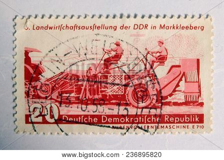 Leeds, England - April 18 2018: An Old Red East German Postage Stamp With An Image Of Agricultural M
