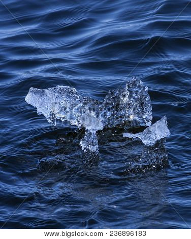 Blocks Of Ice In The Water. Ice In Natural Sculpture Formed By The Waves.