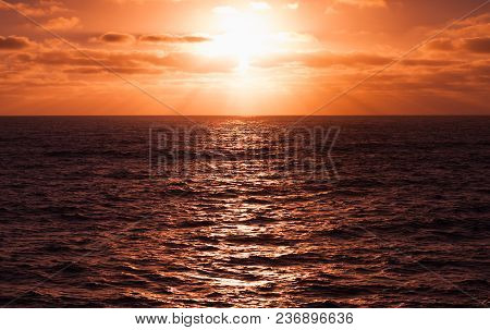 Sun In Dramatic Cloudy Sky. Portugal. Porto Santo Island. Warm Tonal Filter Effect