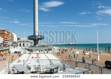 Brighton, United Kingdom - August 1, 2017: Tourists Admire The Amazing View Of English Channel From