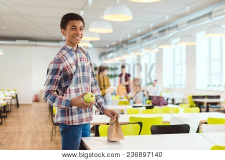 Happy African American Schoolboy At School Cafeteria