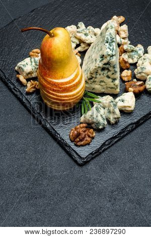 Slice Of French Roquefort Cheese And Figs On Stone Serving Board