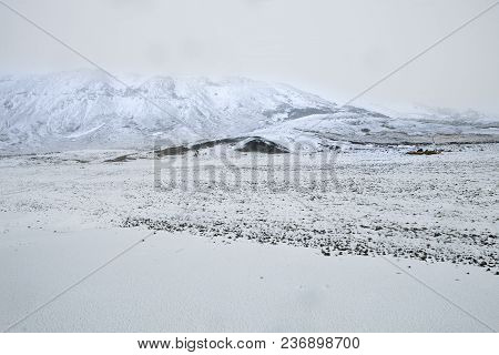 The Snow Covered Mountains Overlook Lake Kleifarvatn In Iceland