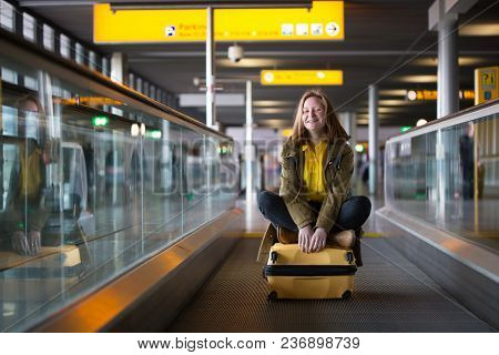 The Girl Is Riding On The Travolator
