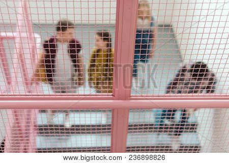 Blurred Shot Of Group Of High School Students On Stairs Of School Corridor