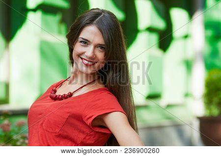 Beautiful Cheerful Brunette Posing On Summer Urban Background