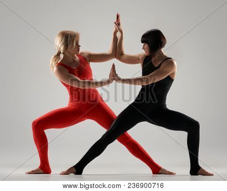 Couple Of Sporty Fitness Models Practicing Gymnastic Yoga