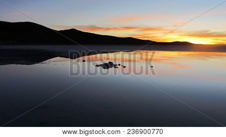 The Mountains Are Reflected In The Salt, By The Light Of Dawn, As If It Were The Sunrise On The Beac