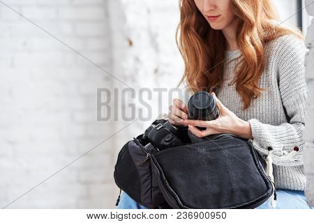 Professional Female Photographer Holding Lens, Focus On Hands