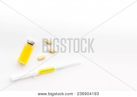 Medical Therapy. Syringe, Bottle With Drug, Pills On White Background Top View.