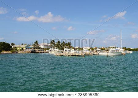 Grand Cayman, Cayman Islands - Dec 23, 2012: Boat Docks And Homes Seen From The Water Along The Coas