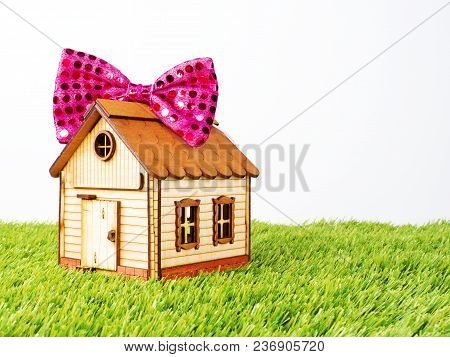Gift, Festive - House. Model Of A House With A Pink Bow