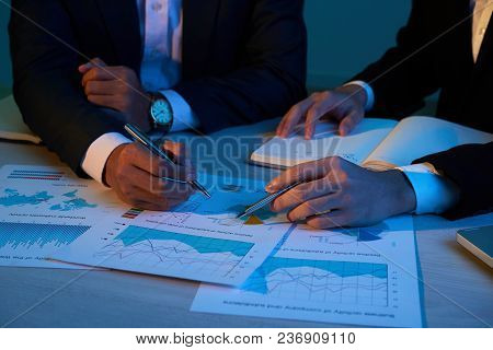 Business People Discussing Documents With Financial Data