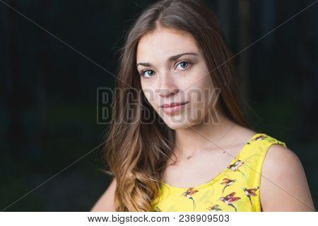 Portrait Of Beutiful Girl With Blue Eyes On Dark Background