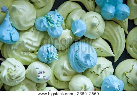 Tender Color Meringue Dessert Background. Green And Blue French Candy. Whipped Egg White