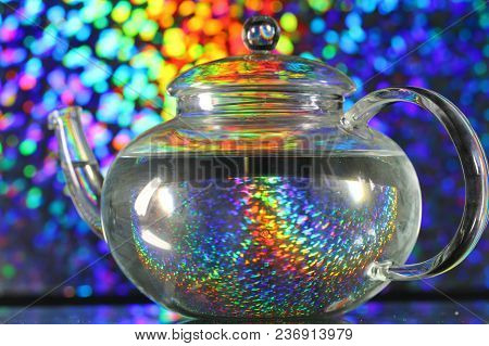 A Glass Teapot On A Colorful Background, Selective Focus.
