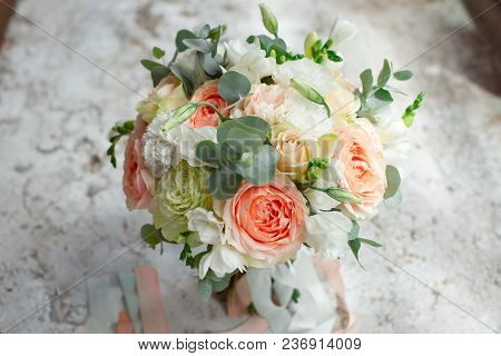 Romantic Arrangement Of Summer Flowers With Roses And Dahlias On Stones