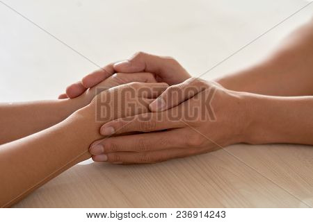 Hands Of Man Reassuring Another Lonely Person