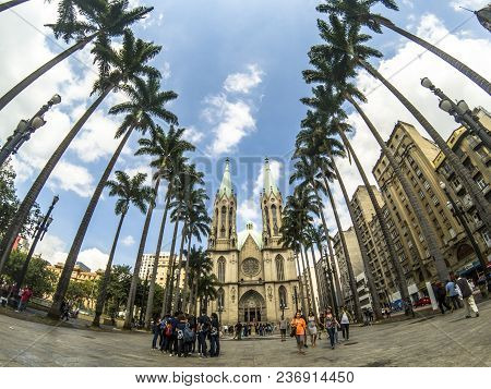 Sao Paulo, Brazil, April 14, 2018. People Walking In Se Square And Facade Of Se Metropolitan Cathedr