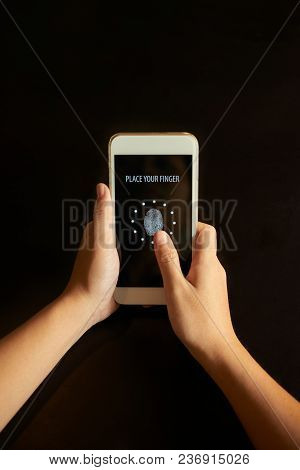 Person Using Touch Sreen Identification Technology On Smartphone