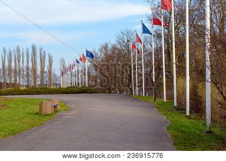 Gdansk Westerplatte, Poland - April 15, 2018: Masts With Flags Along The Road Near Westerplatte Monu
