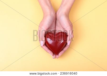 A Woman Holds A Red Heart In Her Hands.